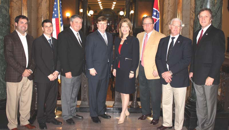 PHOTO SUBMITTED / Lt. Gov. Tate Reeves visited with city and county leaders at Brookhaven day at the Mississippi Capitol. Pictured are Ryan Holmes (Industrial Development vice president), Garrick Combs (executive director Brookhaven-Lincoln County Chamber of Commerce), Eddie Brown (Lincoln County Board of Supervisors president), Lt. Gov. Tate Reeves, Sen. Sally Doty, Tillmon Bishop (chancery clerk), Michael Jinks (city Clerk) and Mayor Joe Cox.