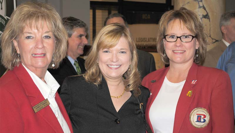 Brookhaven-Lincoln County Chamber of Commerce ambassadors Imogene Ryan (left) and Sheila Burd (right) are seen with state Rep. Becky Currie, R-Brookhaven, at Brookhaven Day at the Capitol Tuesday.