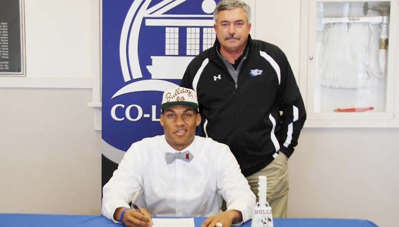 CO-LIN MEDIA / NATALIE DAVIS / HUTCHERSON SIGNS WITH MSU - Copiah-Lincoln Community College (Miss.) tight end Darrion Hutcherson (6-7, 245) of Dadeville, Ala., has signed with Mississippi State University. In his two years at Co-Lin, the Wolfpack posted a 16-5 record, winning the MACJC State Championship in 2012. Pictured with Hutcherson is Co-Lin head coach Glenn Davis.