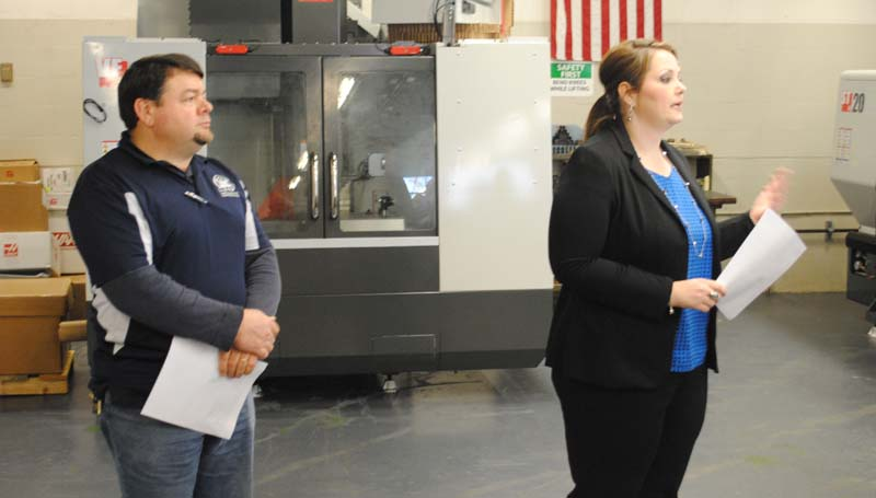 """THE DAILY LEADER / JUSTIN VICORY / Co-Lin Instructor Howard """"Bo"""" Johnson (from left) and Career, Technical and Workforce Education Dean Jackie Martin give the Copiah-Lincoln Community College Board of Trustees a presentation Thursday afternoon on recently purchased state-of-the-art machining technology."""