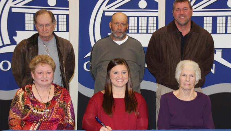 CO-LIN MEDIA / NATALIE DAVIS  / Copiah Academy softball standout Kaitlyn Taylor (seated center) signs to play with the Co-Lin Lady Wolves. Present for the signing were her grandmothers, Becky McIntyre (seated left) and Louann Taylor (seated right), grandfather Mac MeIntyre (standing left), father Rodney Taylor, and Copiah Academy softball coach Terry Bauer.