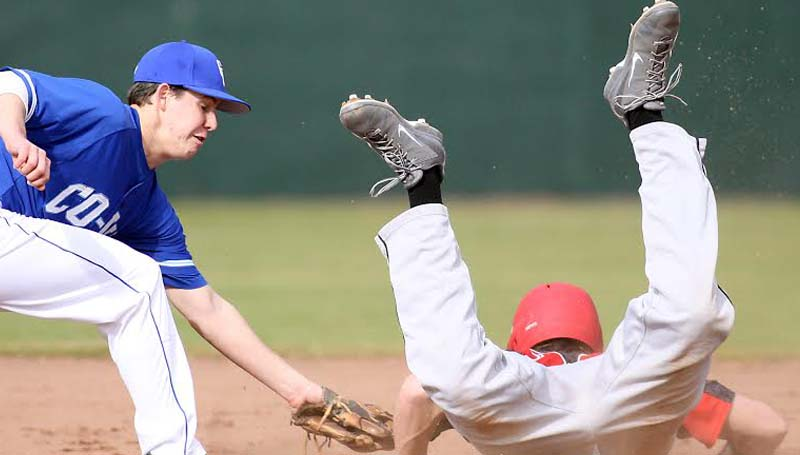 DAILY LEADER / JONATHON ALFORD / Co-Lin shortstop Wesley Watts just barely misses the tag on a Mississippi Delta runner sliding into second base Saturday.