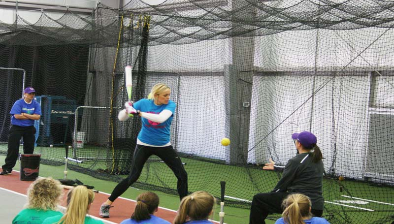 DAILY LEADER / MARTY ALBRIGHT / Olympics gold medalist Jennie Finch provides some helpful tips on batting techniques to several local coaches and girls in Saturday softball camp at KDMC Performance Center.