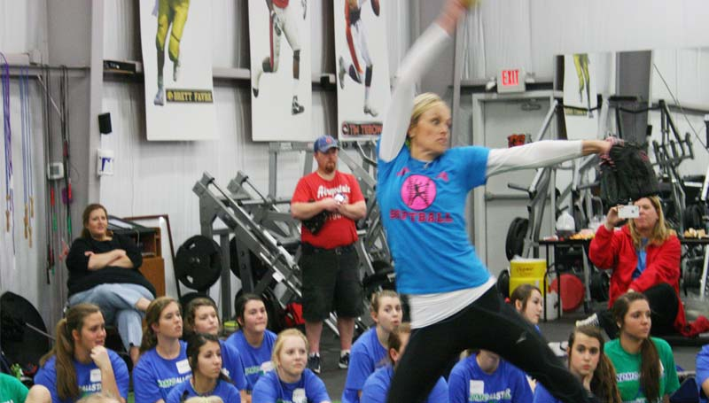 DAILY LEADER / MARTY ALBRIGHT / Olympic and Sports Illustrated star Jennie Finch demonstrates her pitching techniques in Saturday's softball camp at KDMC Performance Center.