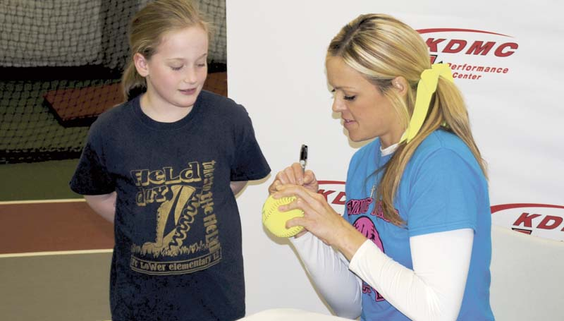 Among those on hand to chat with Finch was Karlee Wallace (right), who got a special signature on her softball. Finch, who Time Magazine recently called the most historic figure in the sport of softball, was joined by area high school coaches in putting on the Saturday camp for softball players ages 10 and up. Finch has been on the cover of Sports Illustrated twice and has struck out not only some of softball best, but Major League Baseball's best, too, such as Barry Bonds, Mike Piazza, and Albert Pujols.
