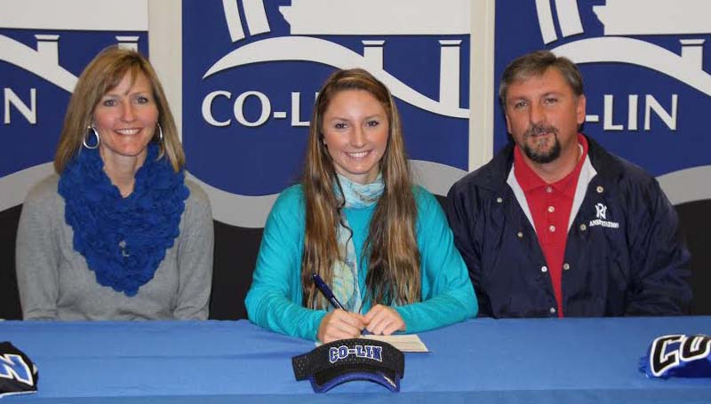 CO-LIN MEDIA / NATALIE DAVIS / North Pike softball standout McKenzie Brock of Summit (seated center) signs to play with the Co-Lin Lady Wolves. Present for the signing were her parents, Leslee and Darryl Brock.