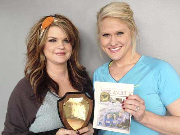 DAILY LEADER / SHERRI MATHIS / Kristy Lambert and Kayla Hart of Serenity Salon and Day Spa hold their Daily Leader ad and its first place MPA award.