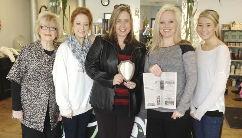 DAILY LEADER / Sidney Tate (fourth from left) holds Sidney's Salon's first place Daily Leader ad and Tracey McGuffee, (third from left) Daily Leader advertising department, holds the ad's MPAt first place plaque. Looking on are (from left) Carmen Rials, Brittany Teaster and (right)ˇAmelia Moore, all of Sidney's.