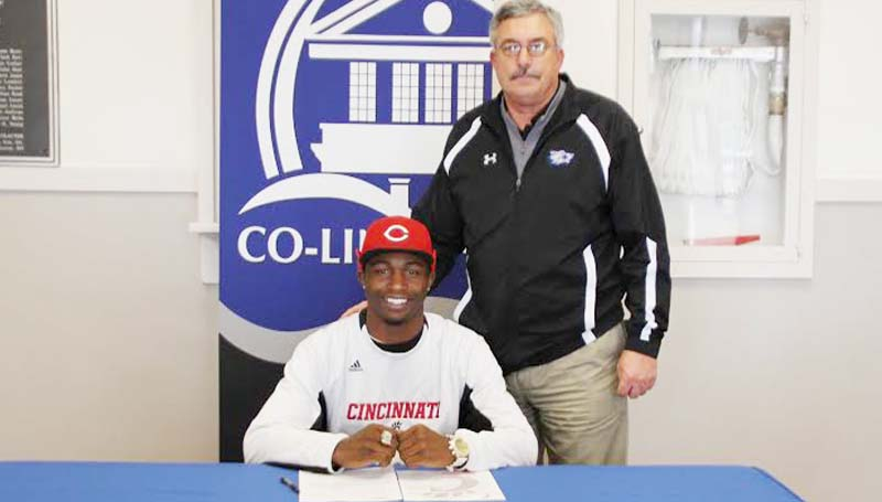 CO-LIN MEDIA / NATALIE DAVIS / GLADNEY SIGNS WITH CINCINNATI - Copiah-Lincoln Community College (Miss.) wide receiver Casey Gladney of Columbia has signed with the University of Cincinnati. In his two years at Co-Lin, the Wolfpack posted a 16-5 record, winning the MACJC State Championship in 2012. Pictured with Gladney is Co-Lin head coach Glenn Davis.