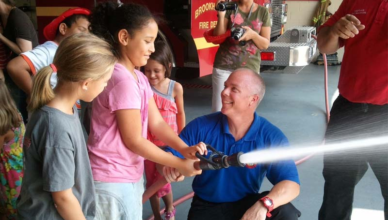 THE DAILY LEADER / KIM HENDERSON / Zoi Kitchens gets a demonstration from a Brookhaven Firefighter on a recent trip the Brookhaven Home Educators group together to see how the city fights fires and responds to emergency calls.