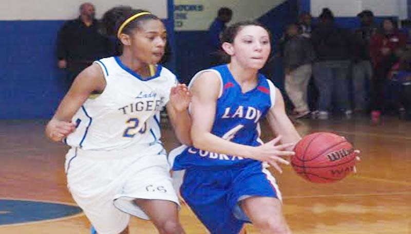 DAILY LEADER / TRACY FISCHER / Wesson Brandi McInnis (4) tries to drive by Crystal Springs' ShaQuan Byther (23) Tuesday night in region basketball action.