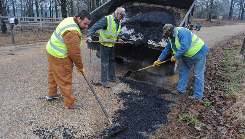 THE DAILY LEADER / JUSTIN VICORY / District Two work crew Jon Athon (from left), Gerald Wilson and James May spent all day Tuesday repairing damage to county roadways as a result of extreme weather conditions.
