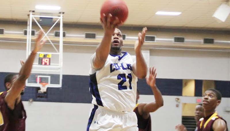 CO-LIN MEDIA / NATALIE DAVIS / Co-Lin power forward Terrance James (21) glides in to score two of his team-high 20 points against Hinds Monday night.