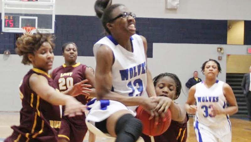 CO-LIN MEDIA / NATALIE DAVIS / Co-Lin sophomore Ashley Minor (13) is fouled by Hinds Latorya Richmond (1) while driving in for a layup Monday night at Mullen Gymnasium.