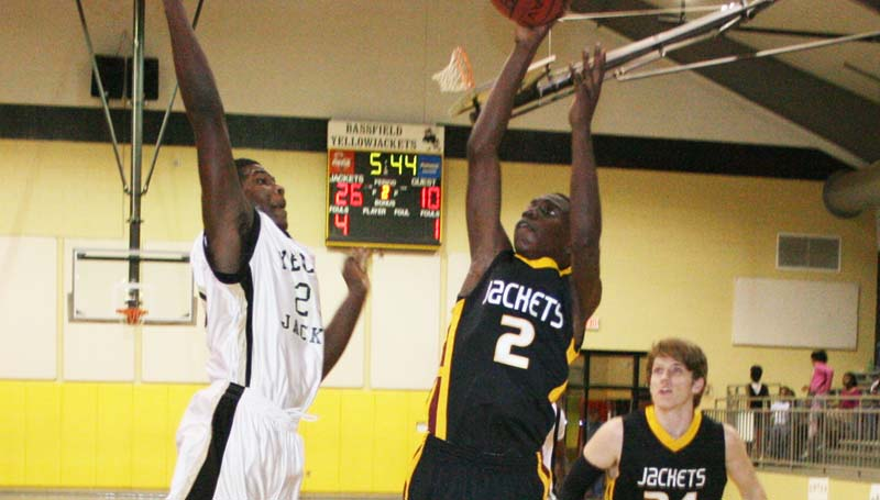 DAILY LEADER / MARTY ALBRIGHT / Enterprise Jontavious Smith (2) shoots a fade away jumper as Bassfield's Lavander Adams (20) leaps to block the shot Tuesday night.