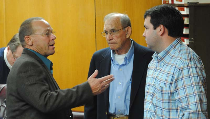 THE DAILY LEADER / JUSTIN VICORY / District Five Supervisor Dudley Nations (from left) confers with District Two Supervisor Jimmy Diamond and Ryan Holmes of Dungan Engineering Tuesday.
