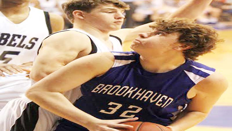 DAILY LEADER / SHERYLYN EVANS / Brookhaven Academy Peyton Hood (32) battles in the low post against ACCS Ryan Strong (3) Saturday.