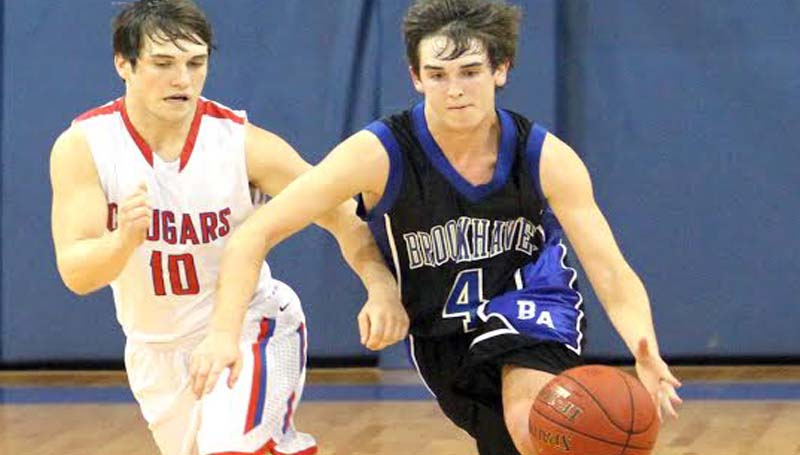 DAILY LEADER / SHERYLYN EVANS / Brookhaven Academy's Caleb Brown (4) drives past Simpson's Kolby Burton (10) Friday night in MAIS State AA boys tournament action at Winona Christian School.