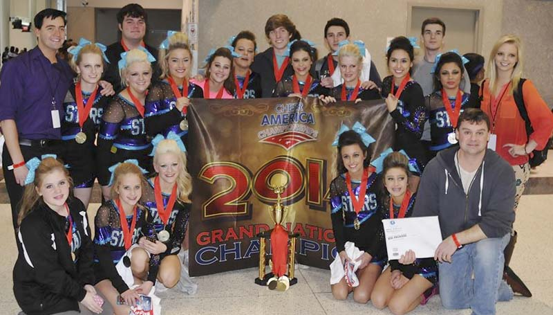 PHOTO SUBMITTED / The Mississippi Gym of Dreams Cheer Team won a spot at the All Star World's Cheerleading Championship held in Disney World in Orlando. Team members posing with their trophy and banner are, Kathryn Meilstrup (front, from left), Maley Moak, Savanna Dunaway, Karley Smith, McKena Henderson, Head Coach Duane Meilstrup; assistant coach/head choreographer Zachary Cain (back, from left), Maya Granger, Brianna Dunaway, Matt Greer, Lindsey Reid, Peyton Herring, Alex Calhoun, Trent Nettles, Mary Anna Rushing, Cody Smith, Sara Harper Dunaway, Elleana Smith, Assistant Coach Caleb Watts, Victoria Riad and assistant choreographer Katie Paulk.