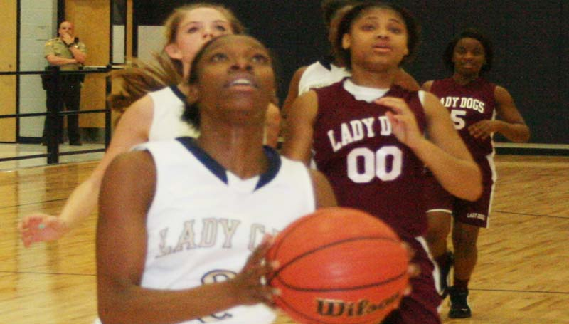 DAILY LEADER / MARTY ALBRIGHT / Bogue Chitto's Zariah Matthews (2) cashes in a break away layup against Dexter Monday night.