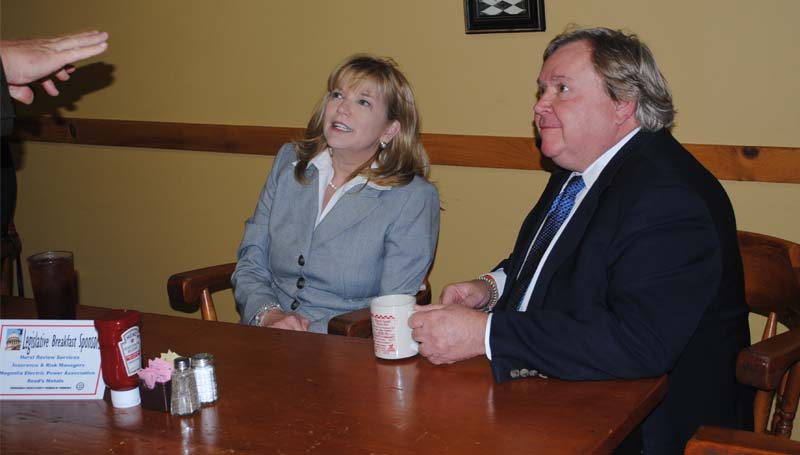 Reps. Becky Currie (left), R-Brookhaven, and Bobby Moak, D-Bogue Chitto, talk with guests before the Legislative Breakfast on Monday at Poppa's Fish House.
