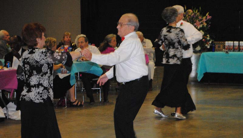 THE DAILY LEADER / RHONDA DUNAWAY / Faye Smith and Chuck Barkley (front left) of The Dancing Stars take a spin around the dance floor in the Lincoln Civic Center during the Senior Prom Monday afternoon. Other dancers with The Dancing Stars are Mary Hopson, Carey Moak, Jim Stewerwald, Sandra Laird and Winnie Lowery.