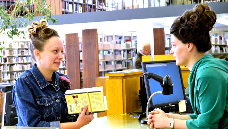 THE DAILY LEADER / RACHEL EIDE / Alexis Smith (right), circulation clerk at the Lincoln County Public Library, checks out books for Jessica Smith Monday. Smith said she is a regular library patron, coming in once a week, and has had a library card since she was a child.