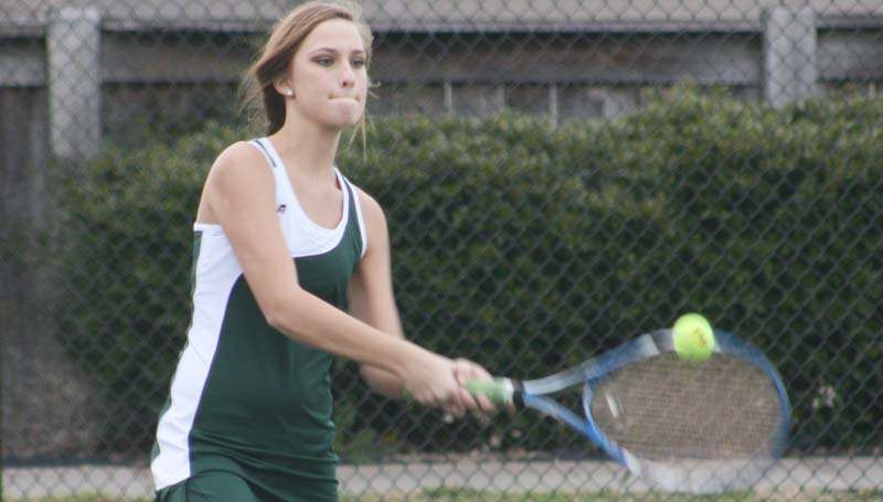 DAILY LEADER / MARTY ALBRIGHT / West Lincoln's Madison Franklin reflects a serve against Franklin County in tennis action Wednesday at Brookhaven Country Club.
