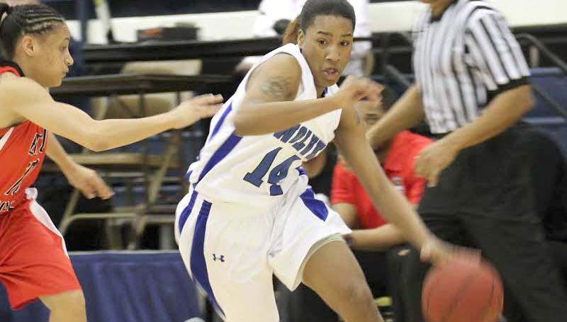 CO-LIN MEDIA / NATALIE DAVIS / Co-Lin Claresa Banks (14) drives to the basket against Baton Rouge's Kasiney Williams (10) Friday.