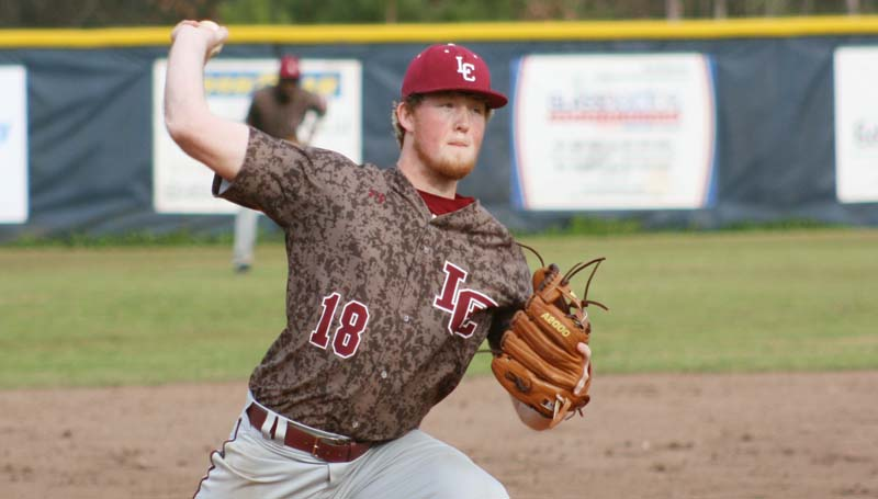 DAILY LEADER / MARTY ALBRIGHT / Lawrence County's Kody Smith (18) earns the win against West Lincoln Friday afternoon.