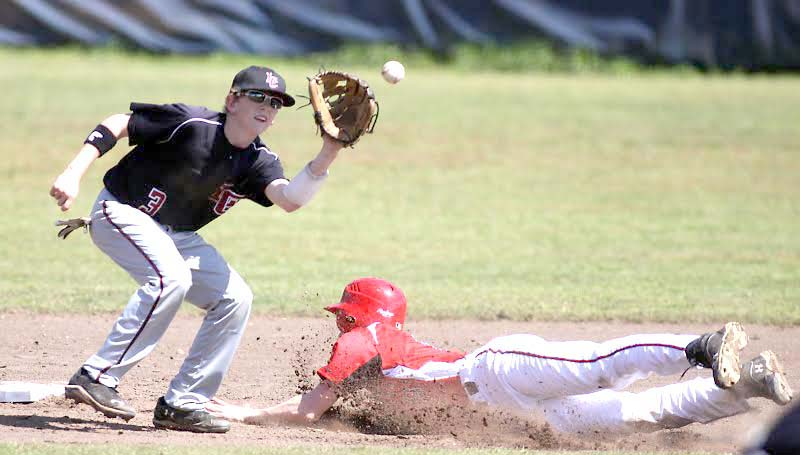 DAILY LEADER / JONATHON ALFORD / Loyd Star's runner Levi Redd slides into second base safely before Lawrence County shortstop Kasey Durr could make the tag Saturday.
