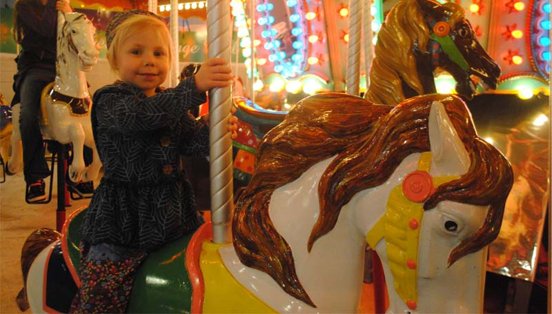 THE DAILY LEADER / JUSTIN VICORY / Camilla Jordan smiles as she spins around the carousel at Exchange Club Park. Area children enjoyed several rides at the park including the Ferris Wheel from 6:30 to 8 p.m. Friday and Saturday nights.