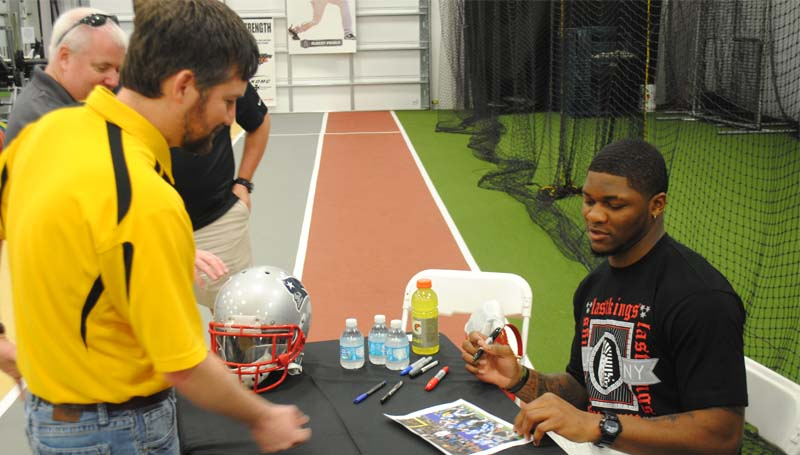 THE DAILY LEADER / JUSTIN VICORY / The New England Patriots' Jamie Collins signs his autograph for Carl Smith at the King's Daughters Medical Center Performance Center Friday night. Collins, from McCall Creek, played college ball at the University of Southern Mississippi.