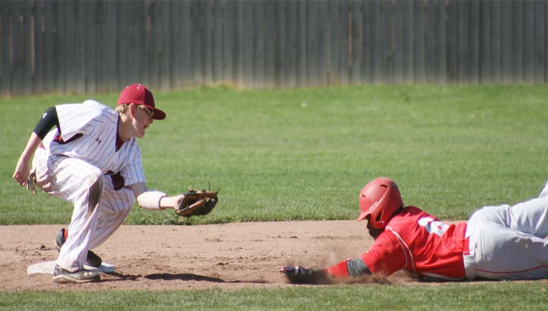 DAILY LEADER / MARTY ALBRIGHT / Lawrence County second baseman Kasey Durr (left) squares up to make the tag on Magee's runner Alonzo Brown (6) sliding in for the out Wednesday afternoon in Southwest Mississippi Spring Break Baseball Classic.