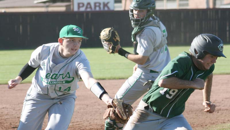 DAILY LEADER / MARTY ALBRIGHT / West Lincoln's third baseman Jeremy Burns (14) tags Natchez Cathedral runner Hayden Nunnery (19) from behind for an out during a rundown at Lawrence County's Jimmie Davis Park.