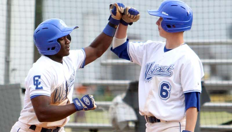 DAILY LEADER / SHERYLYN EVANS / Co-Lin's Wesley Watts (6) congratulates his teammate Dominic Savage (1) at the plate on his two-run homerun in Game One of the doubleheader against East Central Friday afternoon.