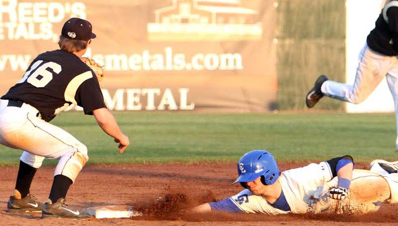 DAILY LEADER / SHERYLYN EVANS / Co-Lin's Ryan Young (14) slides safely into second base after his line drive double to right field, as East Central shortstop Ryan Ward (16) waits on the throw in the second game.