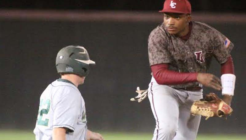DAILY LEADER / JONATHON ALFORD / Lawrence County's T-Tex Cole (right) helps his team record a double play Friday night against West Jones in the Southwest Mississippi Spring Break Baseball Classic, at Jimmie Davis Park.