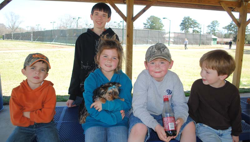 THE DAILY LEADER / RHONDA DUNAWAY / The weather Thursday was perfect for this group of cousins to have a picnic at City Park in Brookhaven. Lane Brister, 5, (from left) Ali Brister, 8, Jaden Cothern, 7, Tyler Russ Cothern, 5, and Hunter Cothern (standing), 13, and the puppy that Santa brought, Maggie Mae.
