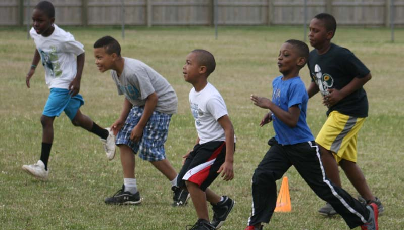 DAILY LEADER / MARTY ALBRIGHT / Several kids came out Saturday and registered for the Brookhaven Southern Wildcat pee-wee league. The kids participated in many different drills on opening day. These kids are practicing line drills.