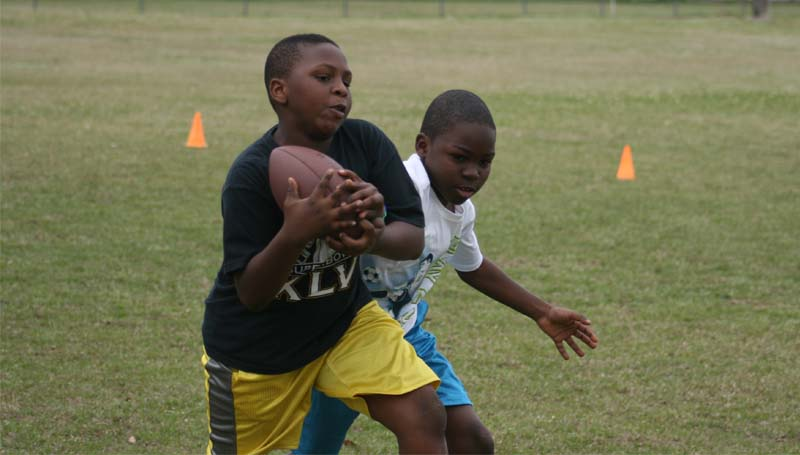 Jazebrian Hooks (front) makes a catch in a passing drill as Elijah Calcote (back) tries to break up the play. The mini camp Saturday was sponsored by the Mississippi Lions Clubs. Home play for the peewee games will be held at King Field. For more information, call Stacy Fells Jr. at 601-757-4440 or Frank Collins at 601-748-3163.