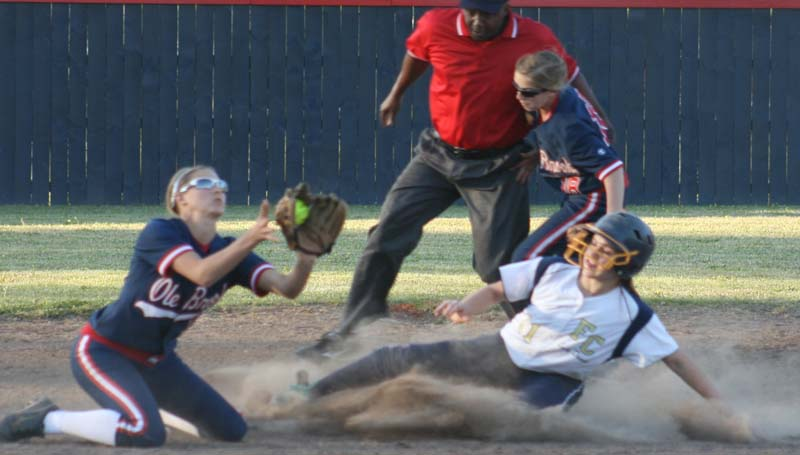 DAILY LEADER / MARTY ALBRIGHT / Franklin County's runner Harley McKay (right) slides into second base safely as Brookhaven shortstop Katie Grace Culpepper receives the throw Thursday in softball action.