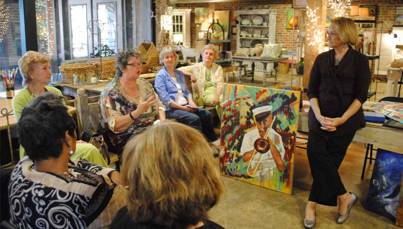 THE DAILY LEADER / RHONDA DUNAWAY / Brookhaven Regional Arts Guild President Sue Minter (standing at right) brainstorms with guild members at their meeting Thursday afternoon at Lemanedi about establishing the organization and promoting the arts in the area.