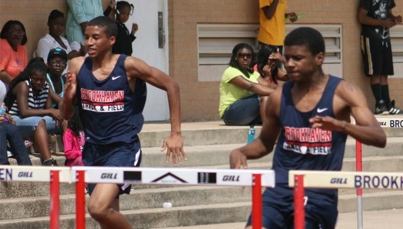 DAILY LEADER / MARTY ALBRIGHT / Brookhaven's Darius Calvin and Tyjah Black compete in the boys 110-meter hurdles Saturday.