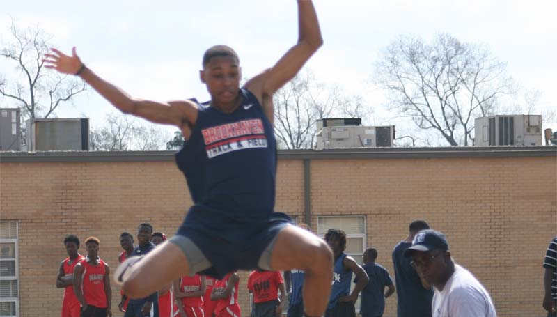 DAILY LEADER / MARTY ALBRIGHT / Brookhaven's Marte Jones soars through the air on his long jump attempt Saturday.