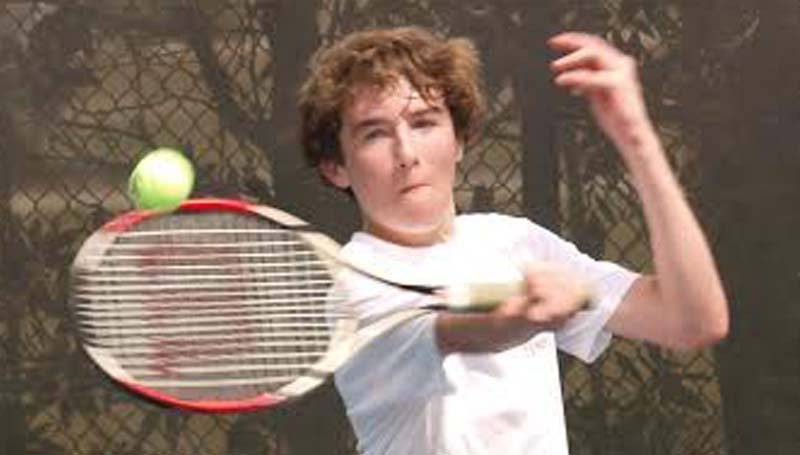 DAILY LEADER / TRACY FISCHER /  Enterprise's Noah McKone returns a serve in mixed doubles action.