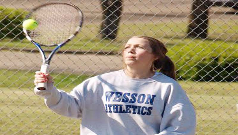 DAILY LEADER / TRACY FISCHER / Wesson's Morgan Wesley returns a serve in No. 1 Girls Doubles action against West Marion Tuesday.