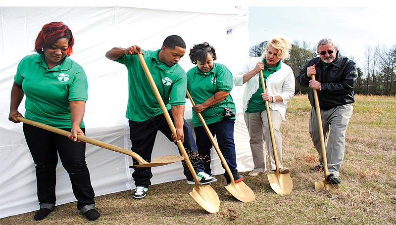 THE DAILY LEADER / JUSTIN VICORY / THE DAILY LEADER / JUSTIN VICORY / Representatives of Florida Care Properties Inc. break ground Wednesday on the construction of a new vocational program center to Brookhaven that will work with intellectually and developmentally disabled community members.. Tonya Bledsoe (from left), Clayton Winston, Jennifer Almo, Suzanne Shannon and Marvin Garrett participate in the ground breaking.
