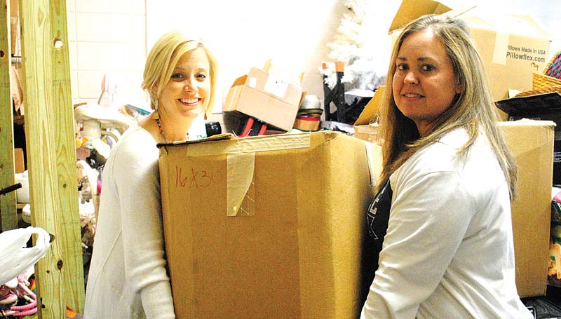 """THE DAILY LEADER / RHONDA DUNAWAY / First Baptist Church Women's Ministry members Sunday Holmes (left)and Missy Kilpatrick are sorting through items for the """"I Love India"""" garage sale coming up next Friday and Saturday, April 4 and April 5."""
