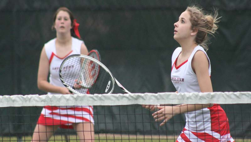 DAILY LEADER / MARTY ALBRIGHT / Loyd Star's Lani Smith (left) and Faith Bergeron wait on the serve from West Lincoln in No. 2 girls double tennis action Friday at the City Courts.
